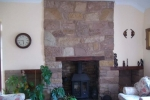 random-rubble-fireplace-with-wooden-features